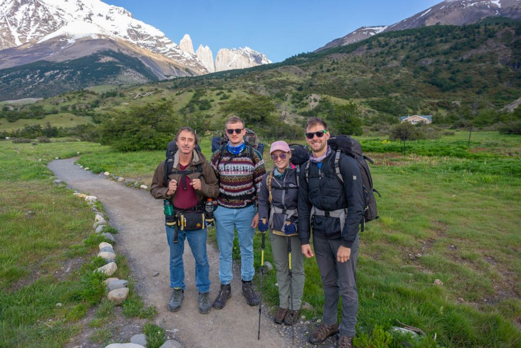 Four people standing at the start of the Torres del Paine trek