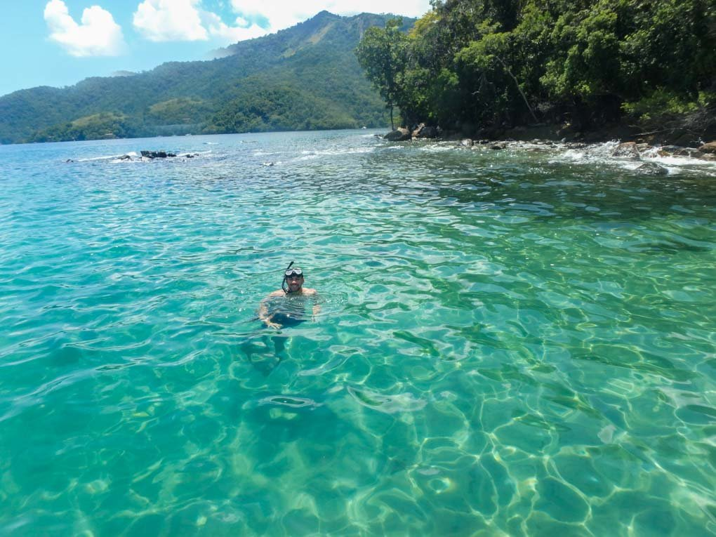 Snorkeling in the water on Ilha Grande, Brazil