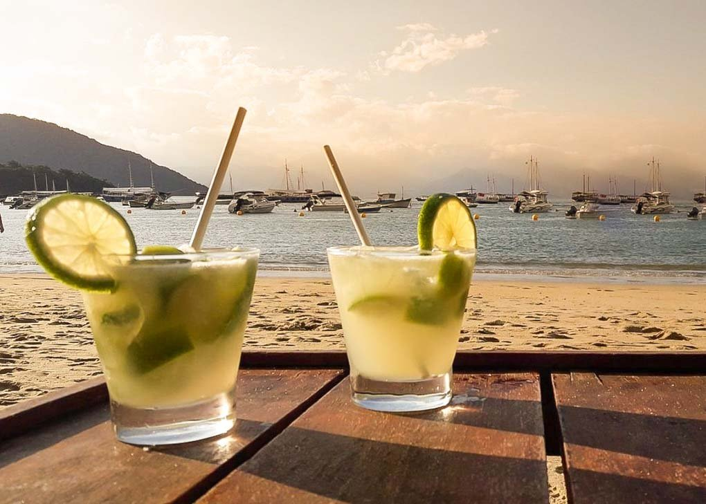 Two Caipirinha's at sunset on Ilha Grande, Brazil