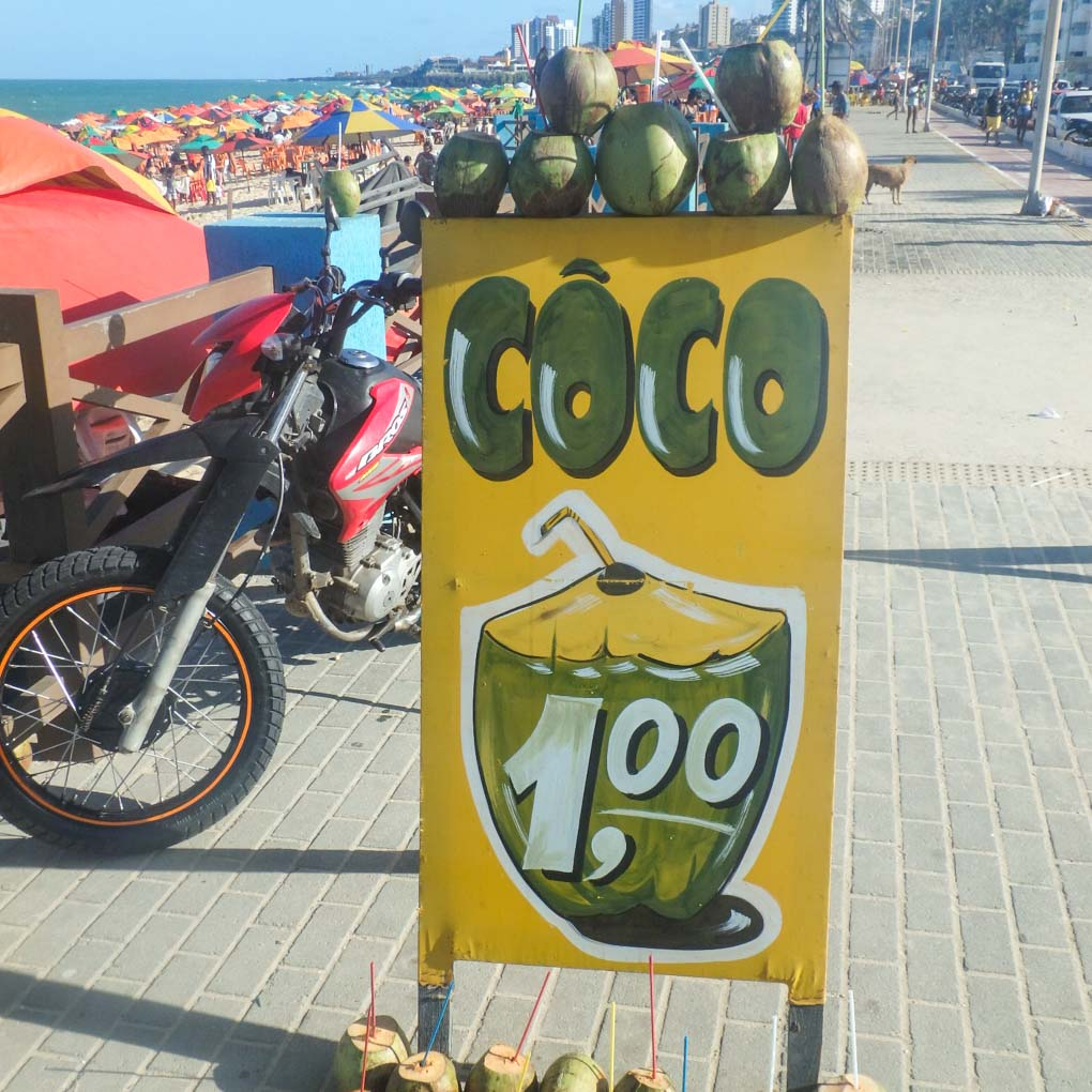 A sign for R$1 coconuts at the beach in Natal, Brazil