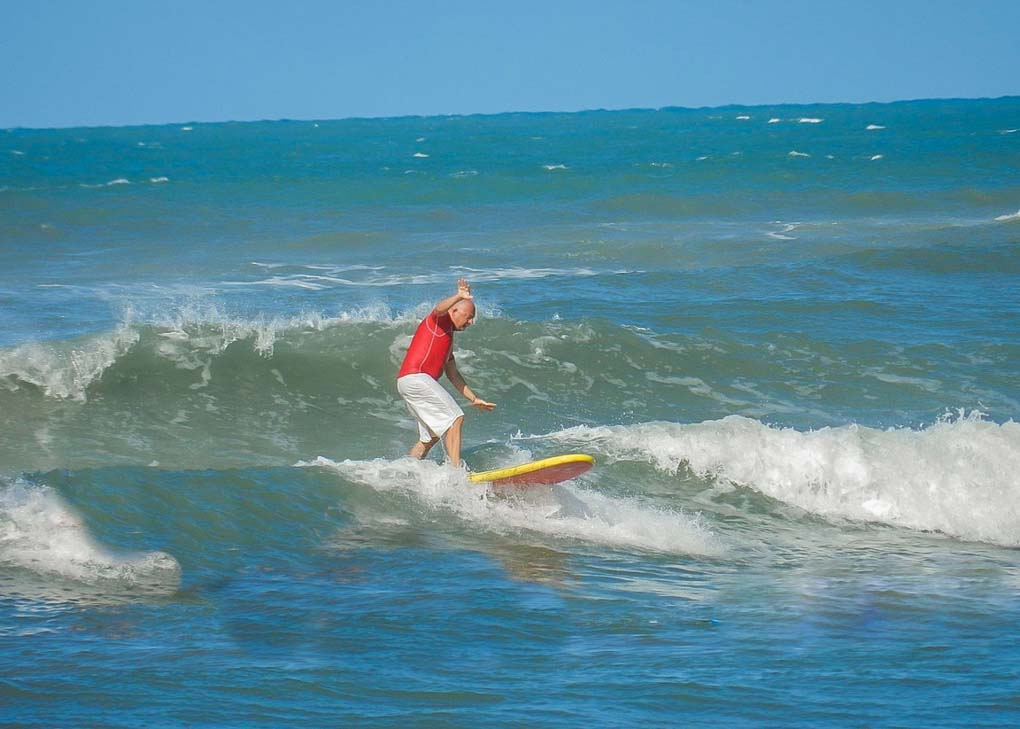 A man surfs in Pipa, Brazil