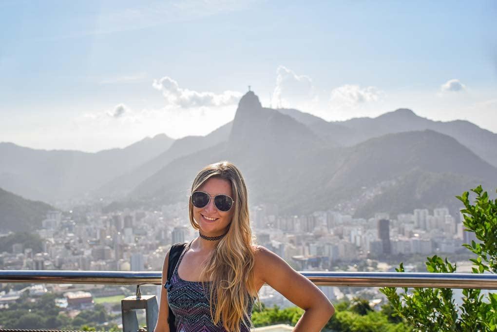 Bailey stands on Sugar Loaf Mountain in Rio de Janeiro, Brazil