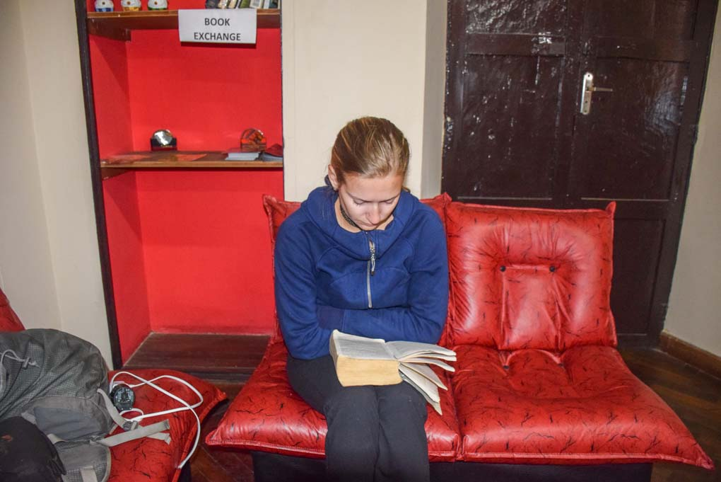 Bailey reading a Spanish book to practice learning in Sucre, Bolivia