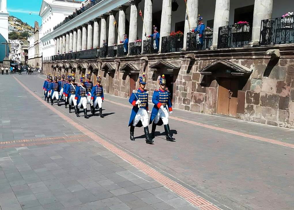 Guards march through the street during the changing of the guard in Quito, Ecuador