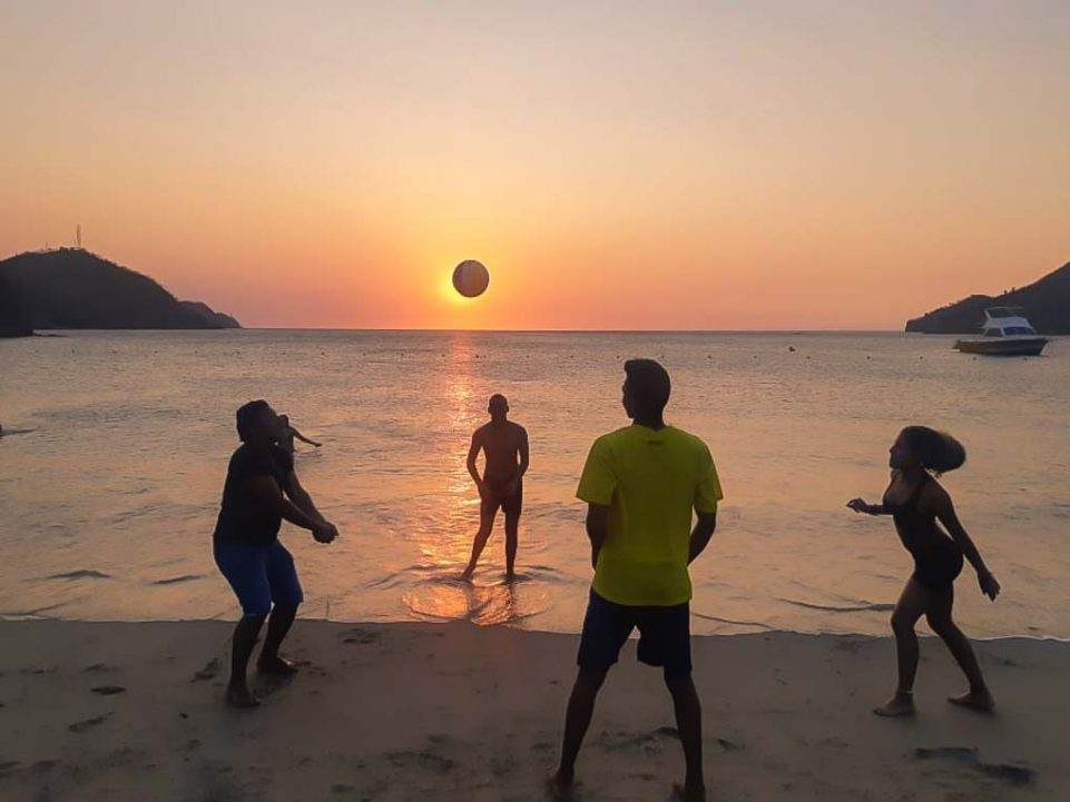 People play beach volley ball in Taganga