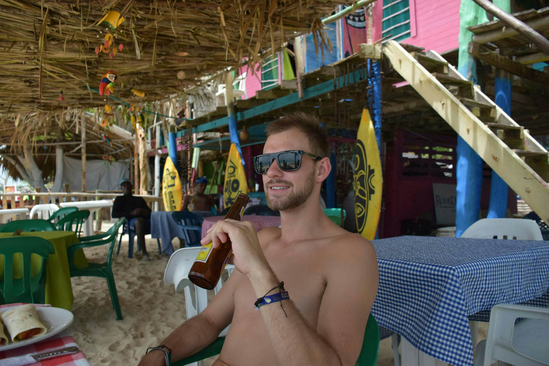 having a beer at Playa Blanca near Cartagena