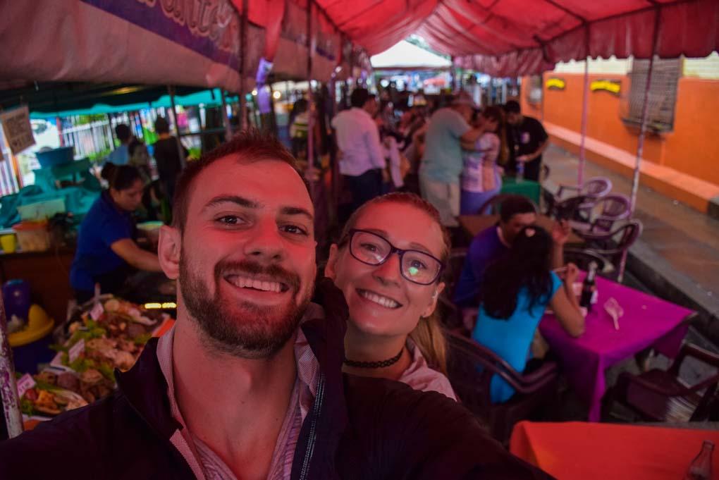 ailey adn Daniel take a selfie at the food festival in Juayua