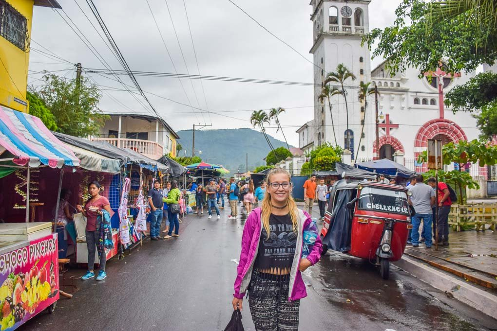 A lady walks down a street in the town of Juayua on the Ruta de las Flores