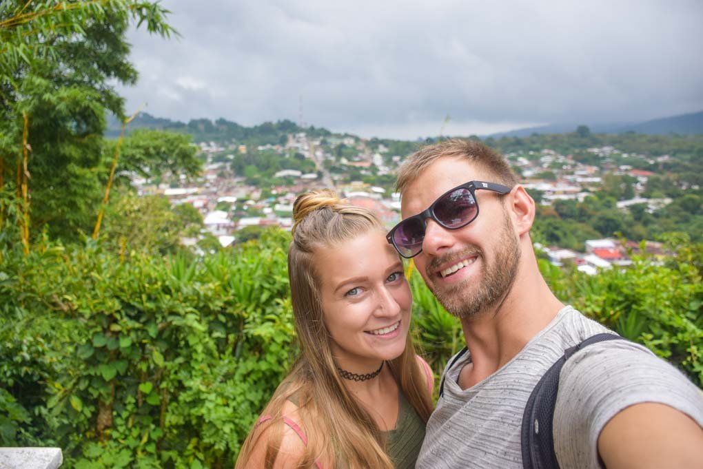 A couple take a selfie on the Ruta de Las Flores, El Salvador