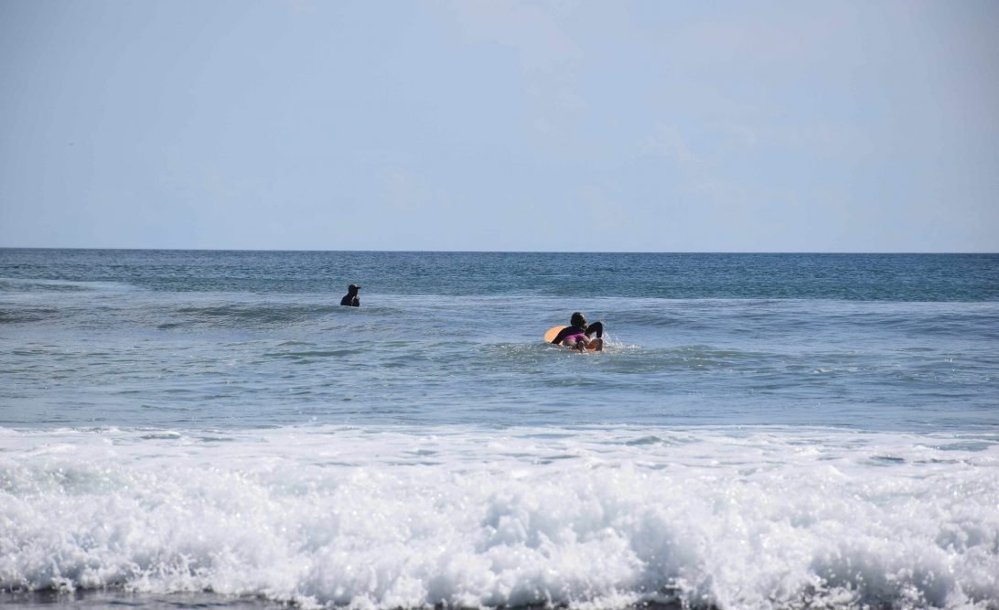 San Juan del Sur surfing paddle out