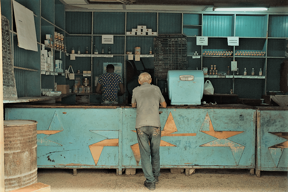 A man buys monthly rations at a government-owned store