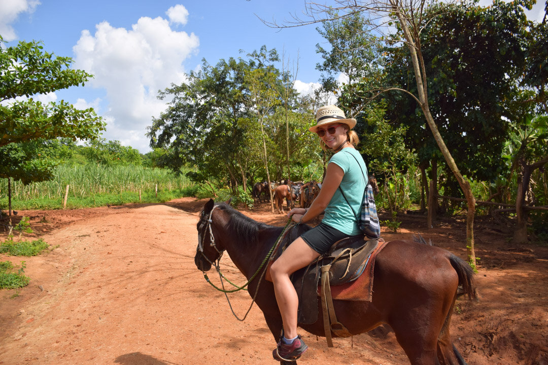bailey riding a horse in vinales, cuba