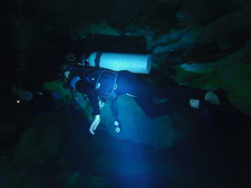 Diving in a cenote in Tulum