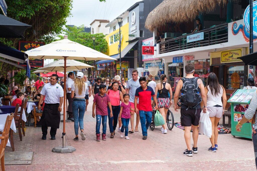 people walking on Fifth Avenue in Playa del Carmen, Mexico