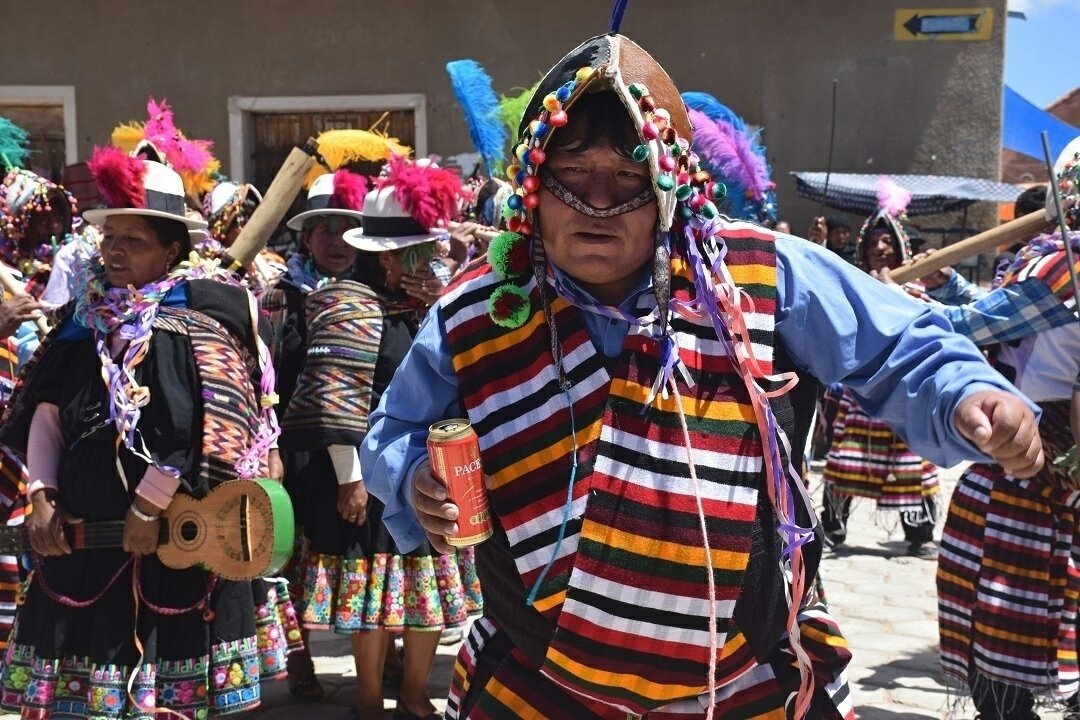 A man dances in traditional Bolivian clothing in Bolivia