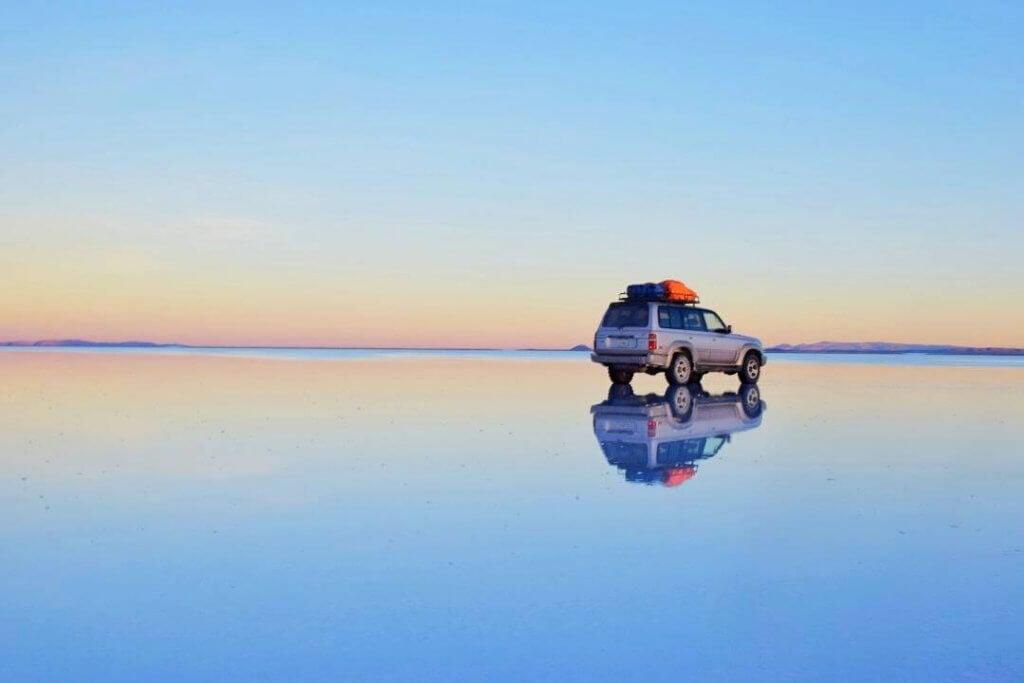 car on the salt flats in bolivia
