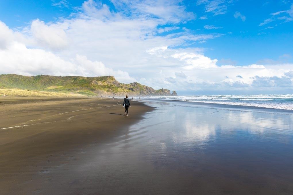 Walking along Bethells Beach New Zealand