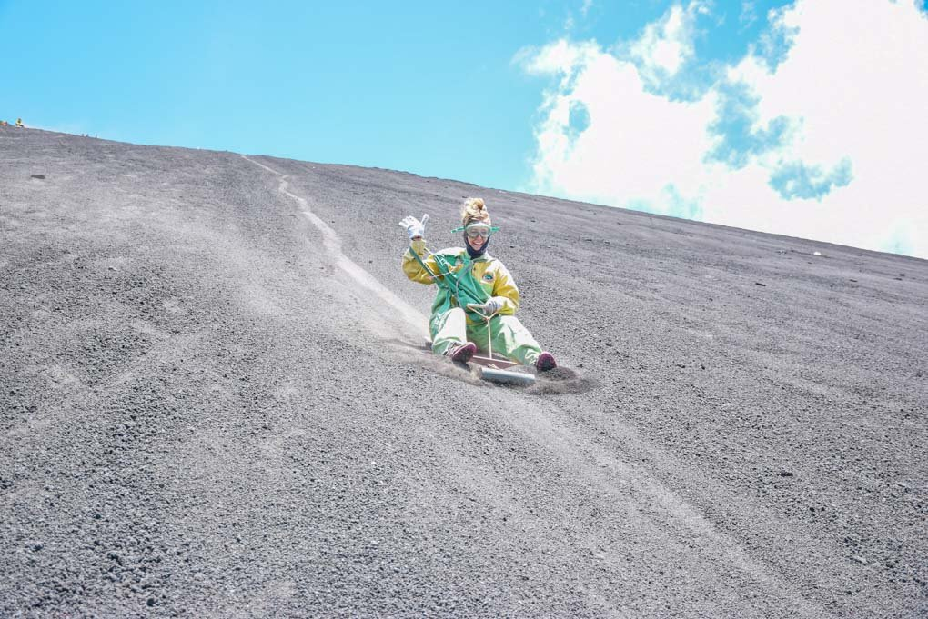 Bailey sliding down the Cerro Negro Volcano during the famous volcano boarding tour near Leon, Nicargua