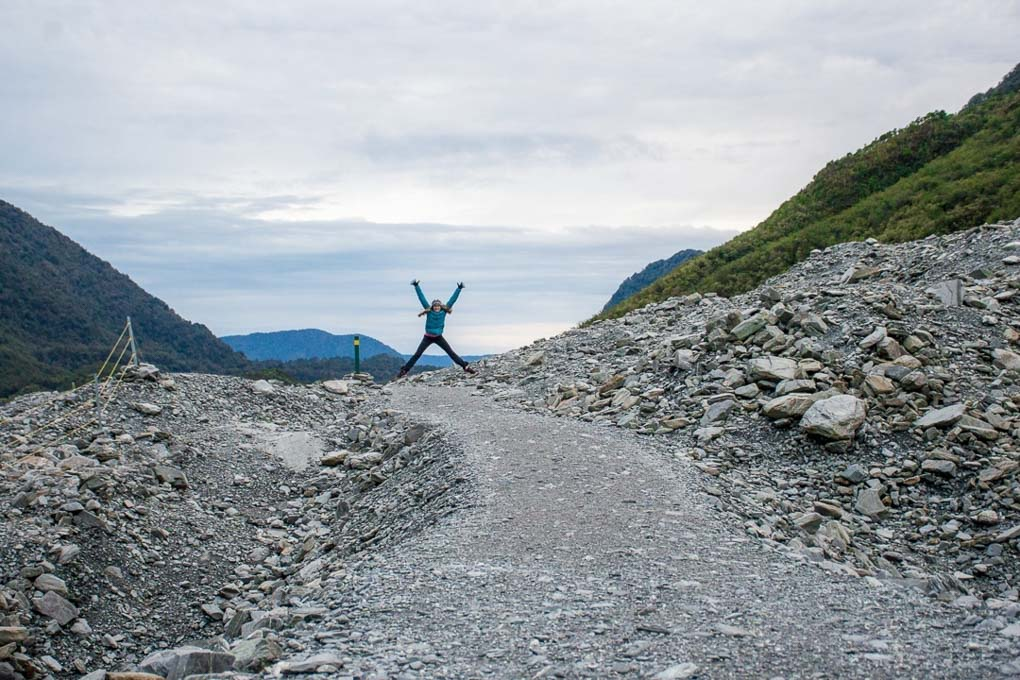 Bailey jumping in the air on the Franz Josef Glacier valley walk