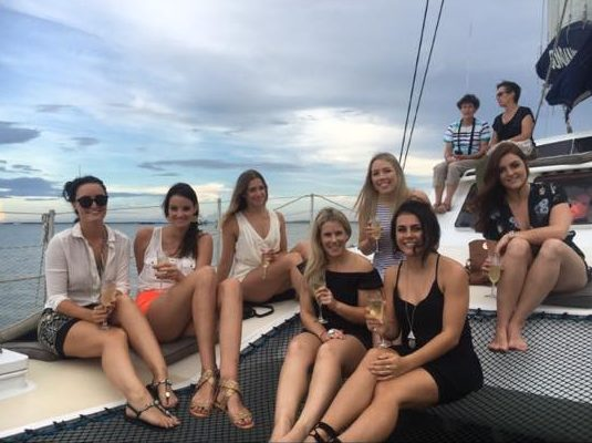 girls sitting on a catamaran for a darwin sunset cruise