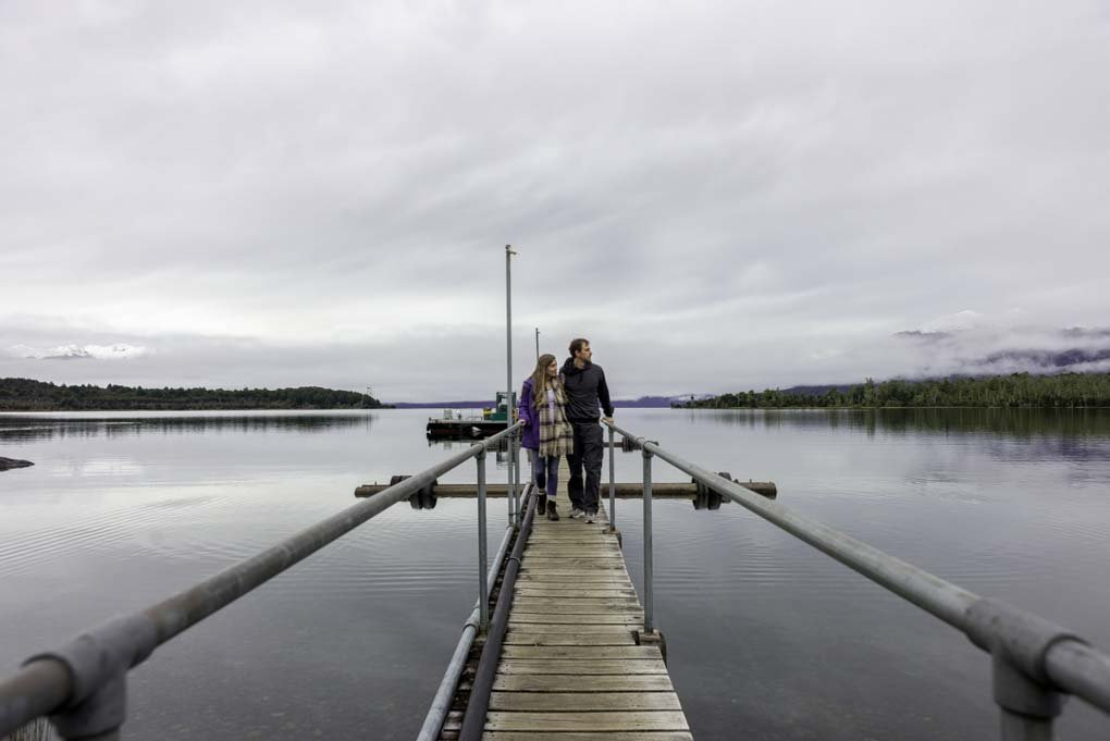 Bailey and I walk along the jetty in Te Anau Downs, New Zealand