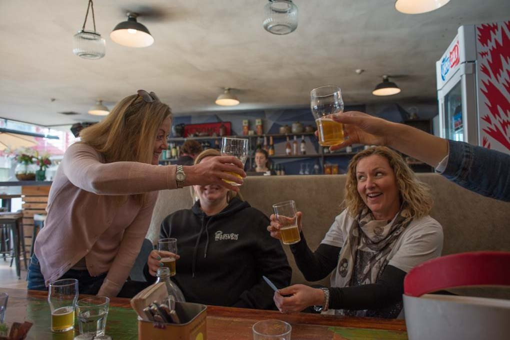 Peaple cheers on a Queenstown craft beer tour