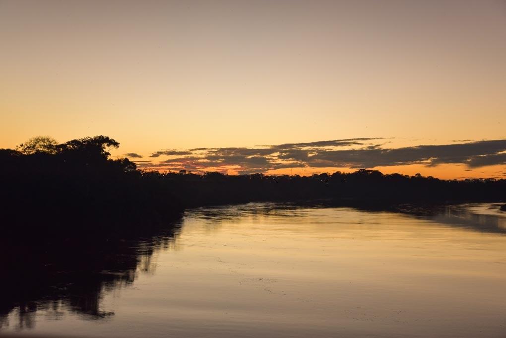 sunset over the river in Puerto Maldonado