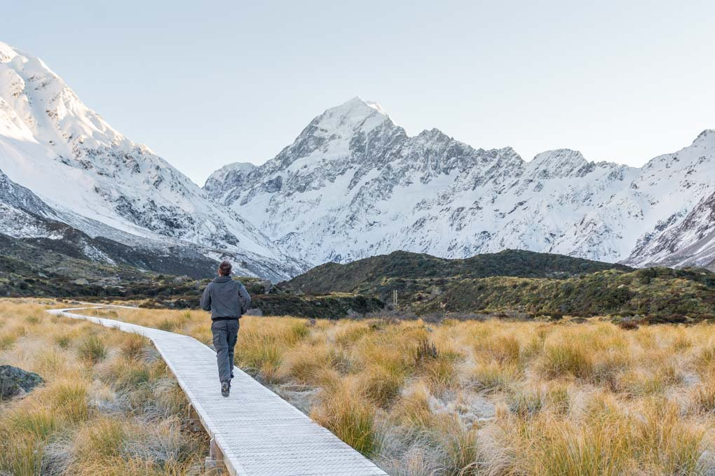 Daniel walking along the boardwalk of the Hooker Valley Track