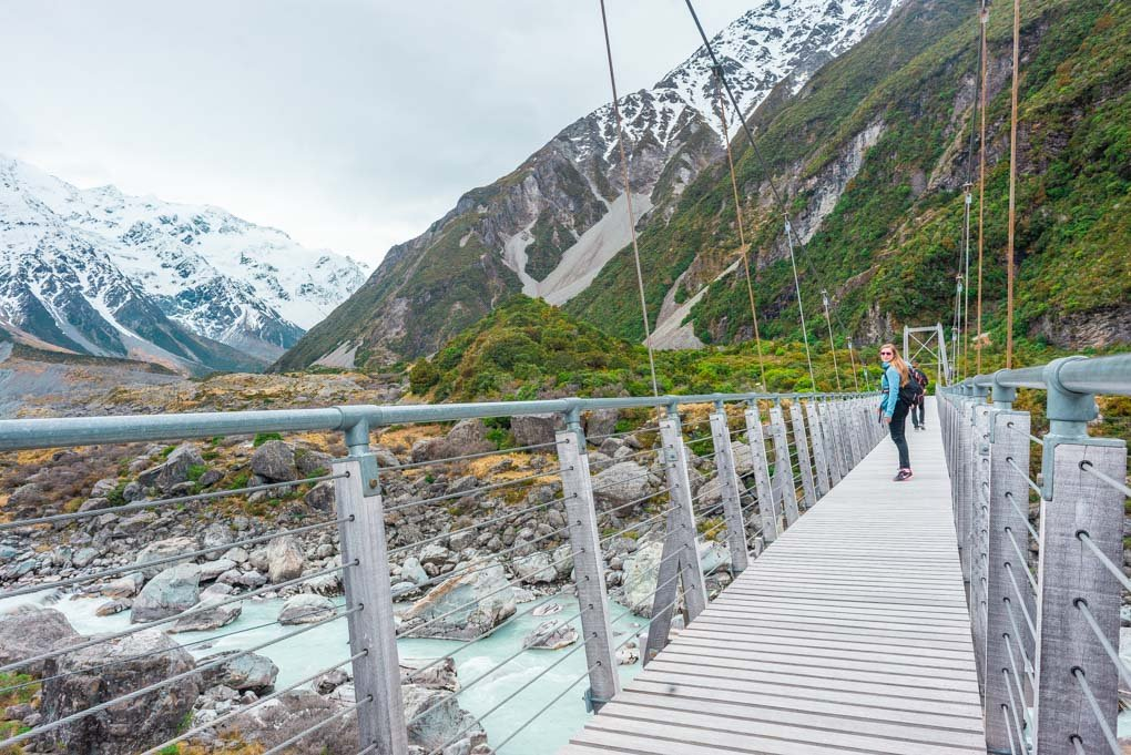 Bailey on a suspension bridge on the Hooker Valley Track looking out over the Hooker River