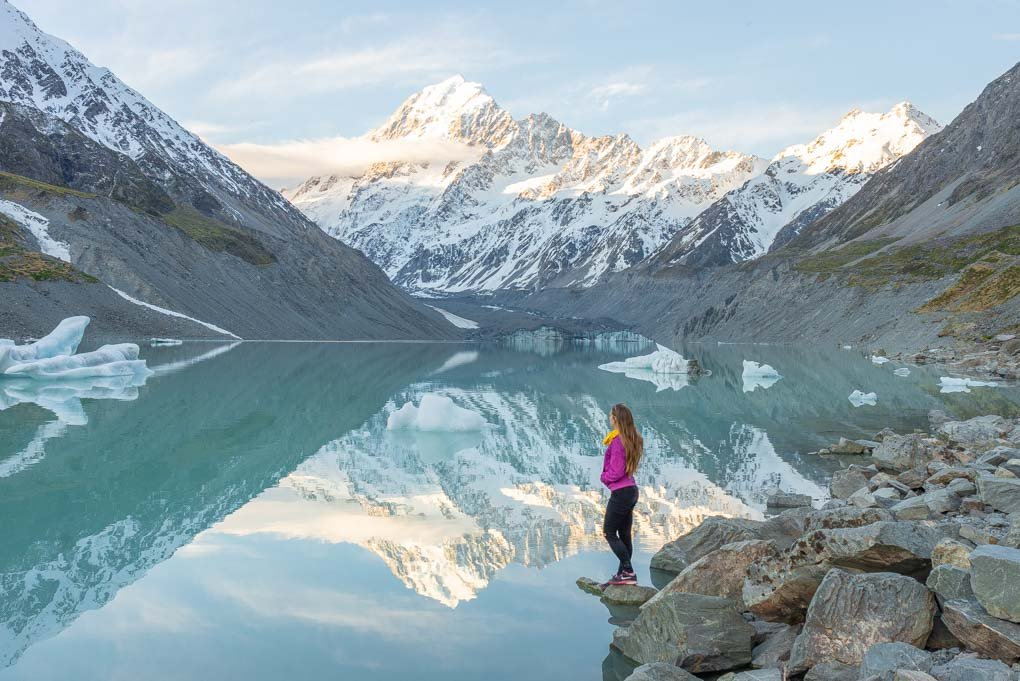 Bailey watching the sunset behind Mount Cook and the Hooker Lake, New Zealand