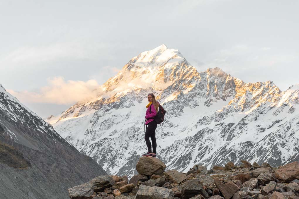 Baiely standing in the shodow of Mount Cook on the Hooker Valley Trail