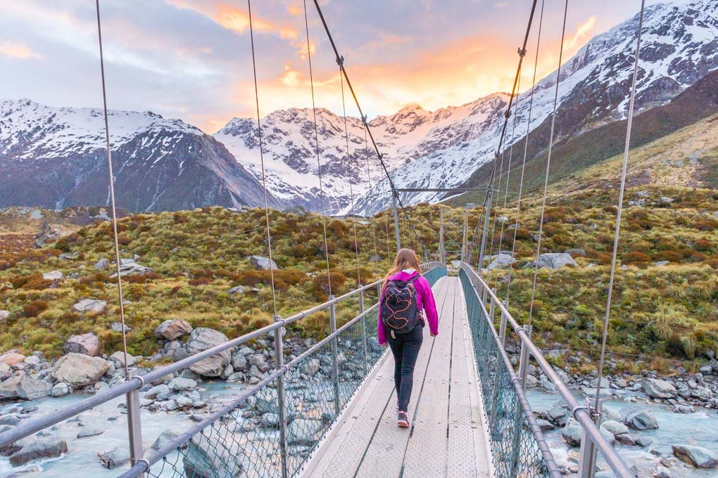 Bailey walking on one of the suspension bridges on the Hooker Valley Track in Mount Cook National Park, New Zealand