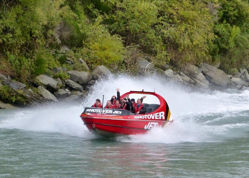A Shotover Jet speeds through the Shotover River near Queenstown