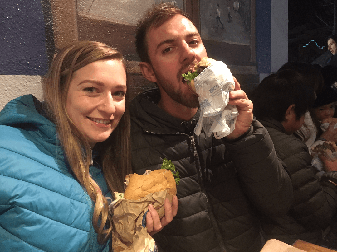 Daniel and Bailey eating Fergburger burgers in Queenstown, NZ