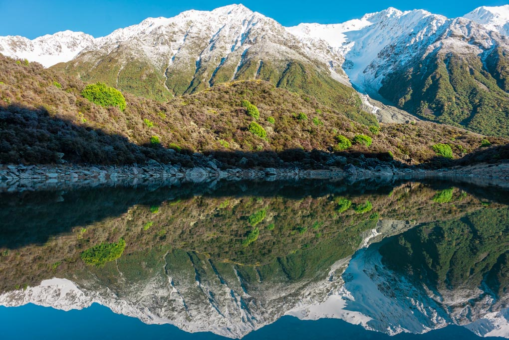 A reflection at the Blue Lakes near the Tasman Glacier and Tasman Lake