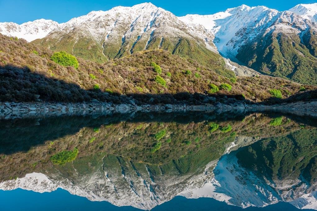 A reflection at the Blue Lakes near the Tasman Glacier and Tasman Lake