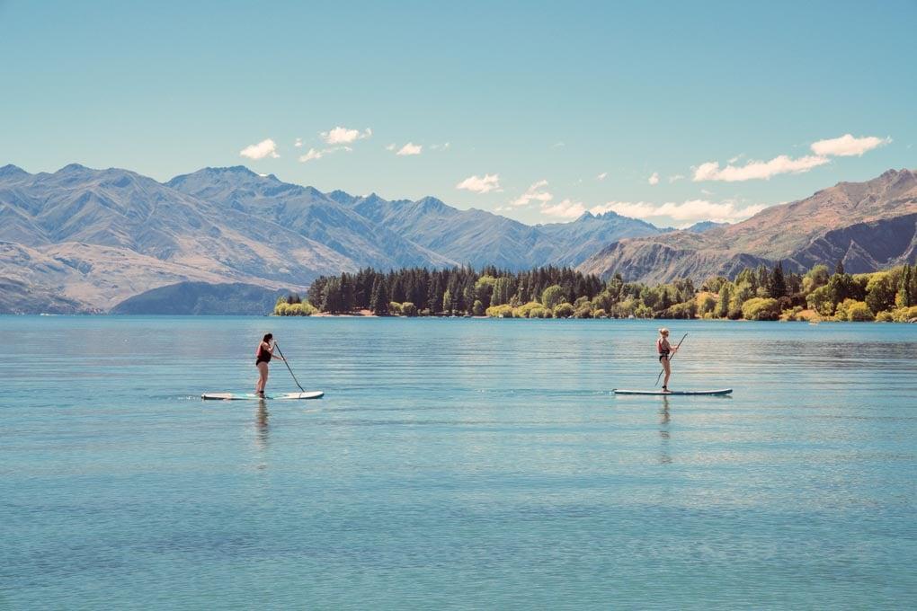 People paddle boarding on Lake Wanaka, New Zealand