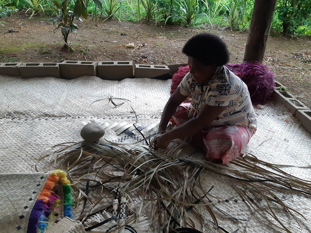 a weaving demonstration at the Fiji Culture Village