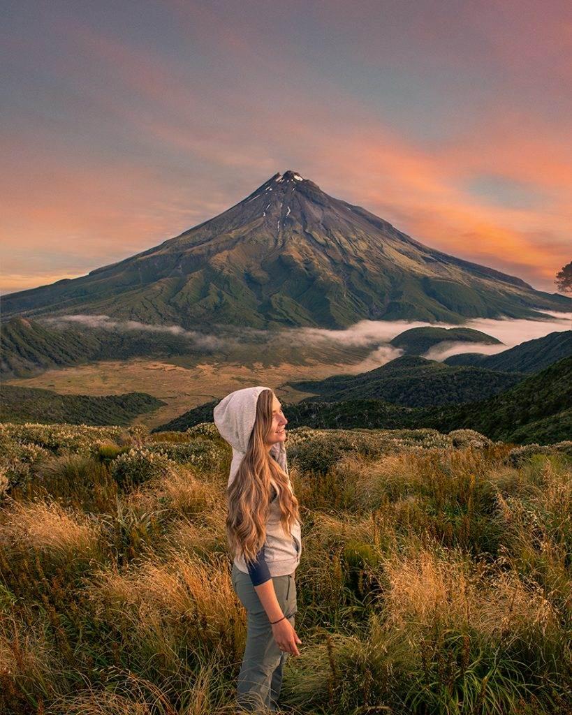 enjoying a sunset at the Pouakai Hut with views of Mount Taranaki