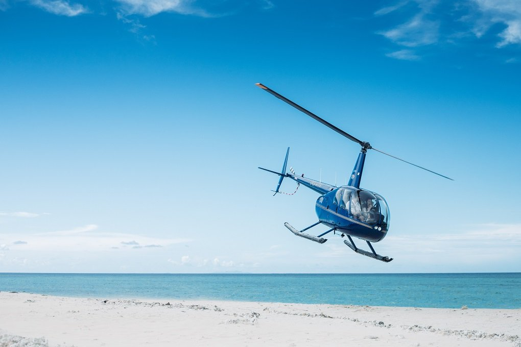 helicopter landing on a beach in Fiji