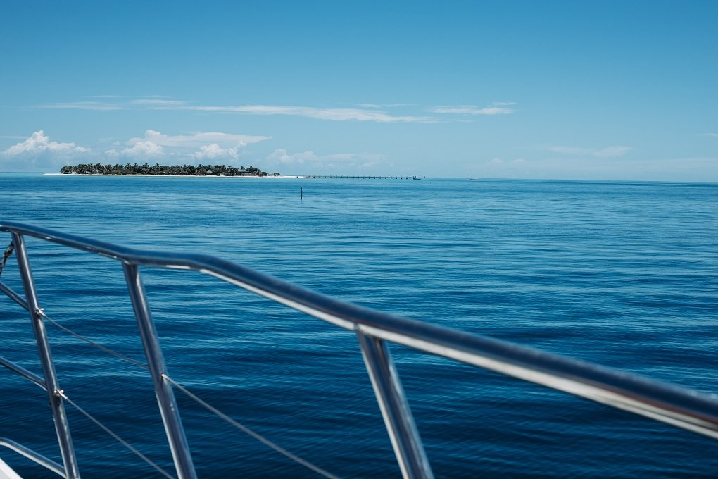 Looking over a railing on a cruise in Fiji