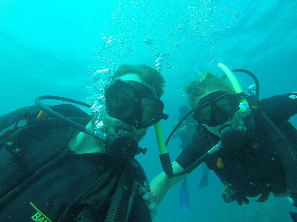 daniel and bailey taking a selfie while scuba diving