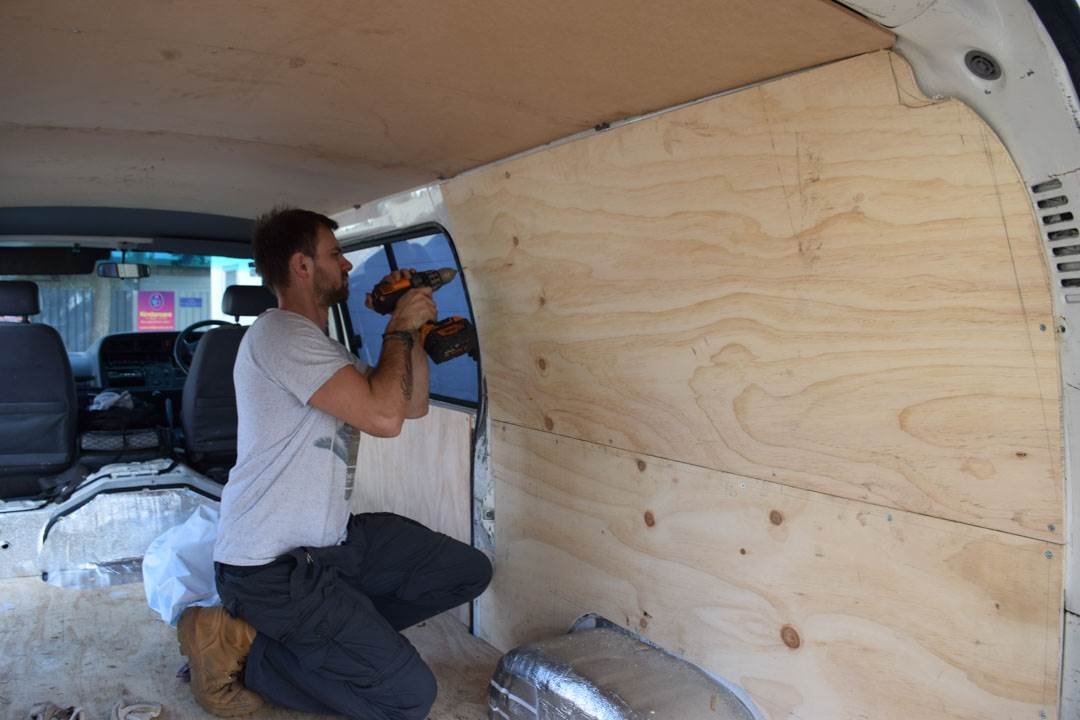 installing the walls in the van