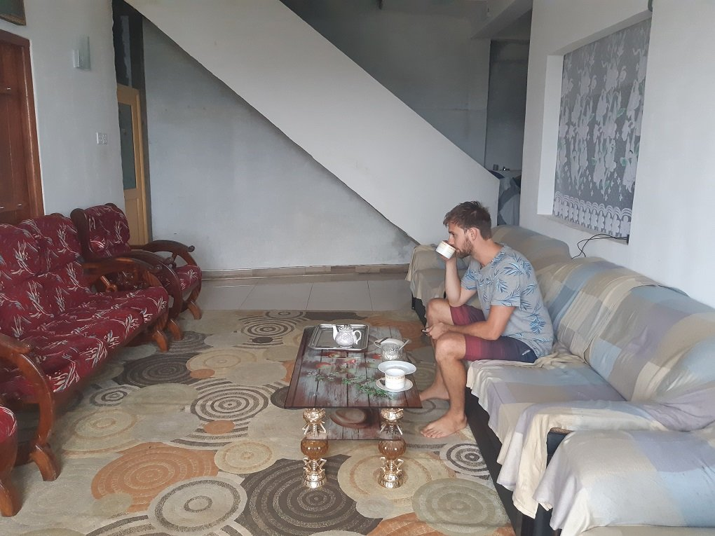 danile drinking tea at our guesthouse in haputale sri lanka