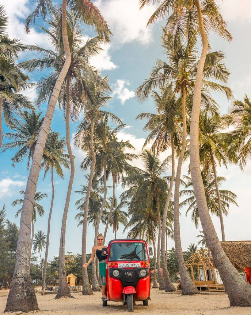 Posing with our tuk tuk at Nilaveli Beach, Sri Lanka