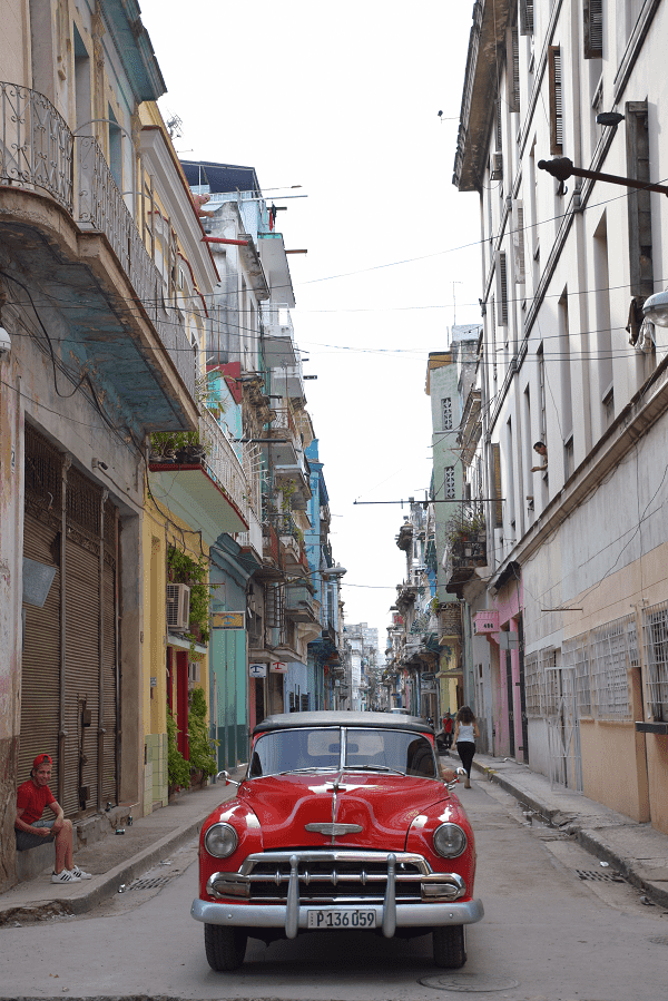 A beautiful car in an old street in central havana cuba