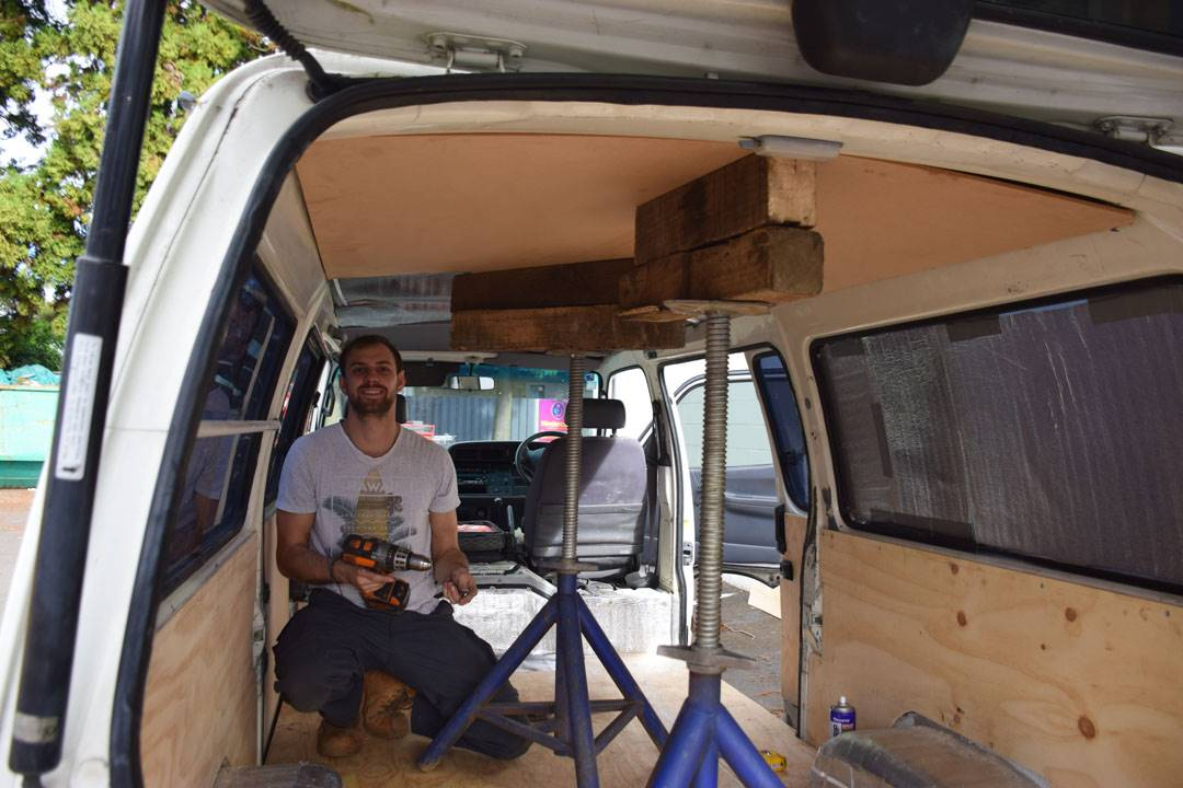 lifting the roof into place during our campervan conversion