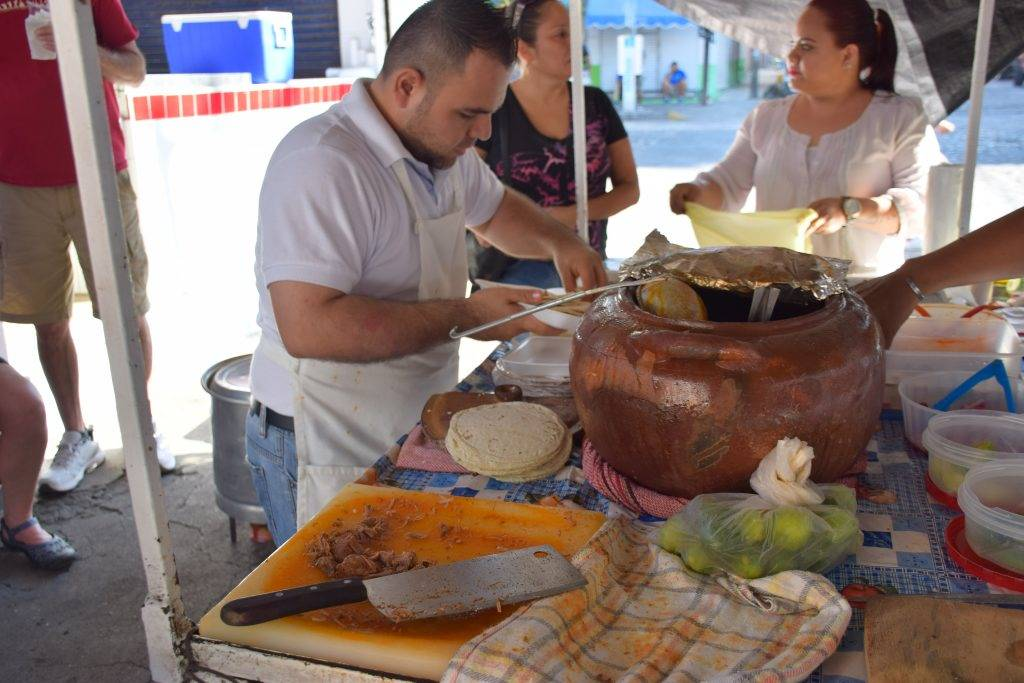 man at a taco stand in mexico