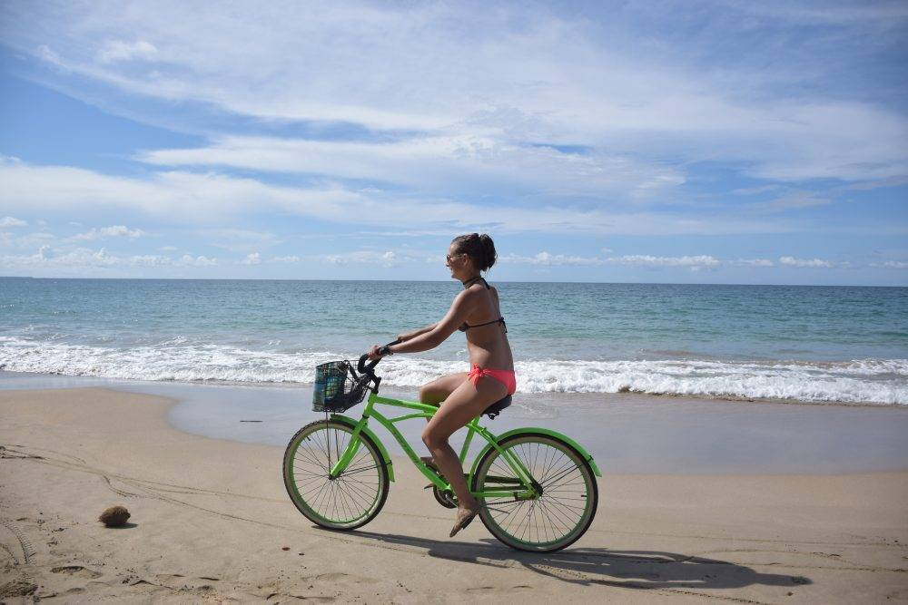 Riding a bike on the beach in Tulum