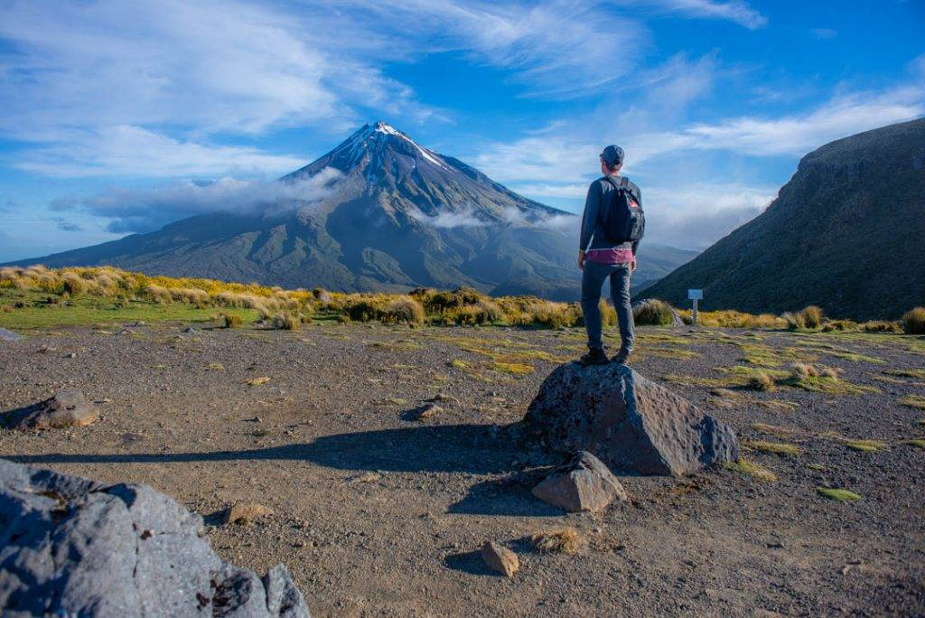 standing on a rock with a view of Mt Taranaki